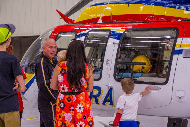 Family looking at new helicopter at Amarillo Press Event